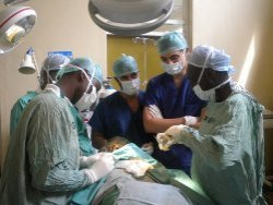 Medical internship students observe a surgery in Kenya