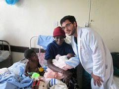 Midwife Volunteering: Ben (USA) having just helped a delivery