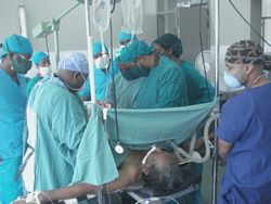 Volunteer Assists in Surgery