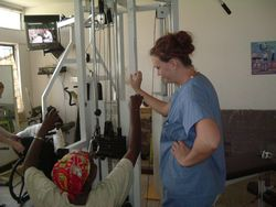 Volunteer in East Africa: physiotherapy medical volunteer assists in a spinal injury clinic