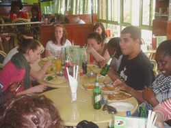Volunteers taste local food during orientation.