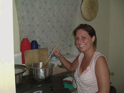 Chelsea, a volunteer in Kenya, helps in preparing a meal.