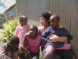 A Volunteer plays with orphanage children in Kenya.