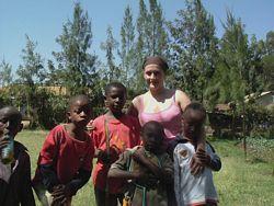 A Volunteer plays with children in a Kenya Children's Home.