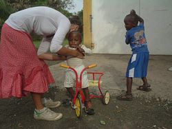 Kenya Volunteer Orphanages - A Volunteer plays with Kids in an Orphanage.