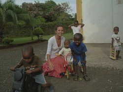 Volunteer teaching:  Volunteer teacher plays with school children in Tanzania.