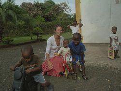 Volunteer teaching:  Volunteer teacher plays with school children in Tanzania.