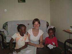 A Volunteer plays with children in Kenya.