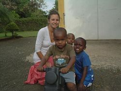 A Volunteer plays with orphanage children in Tanzania.